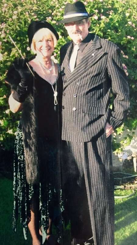 920's Mens Gangster and 1920's Green Womens Dress